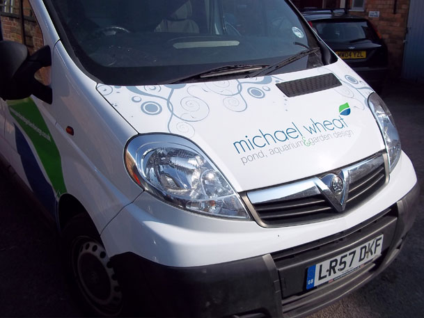 Sign makers vehicle graphics for Michael Wheat